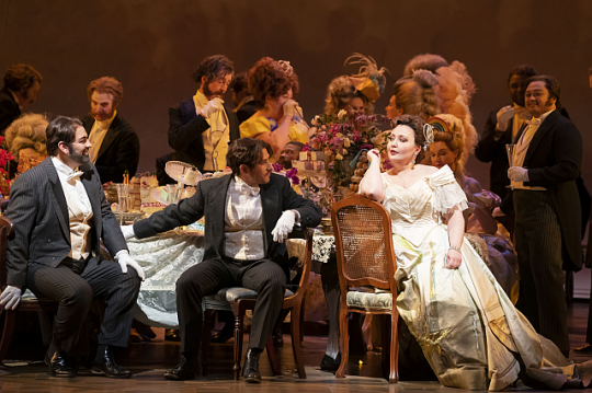 L-R: Giorgio Berrugi/Alfredo, Mario Rojas/Gastone, Albina Shagimuratova/Violetta -- in La Traviata at Lyric Opera of Chicago. (Photo: Todd Rosenberg)