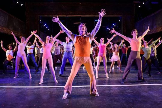 Company of 'A Chorus Line (Richard Strimer as Zach) center) at Porchlight Music Theatre. (Michael Courier photo)