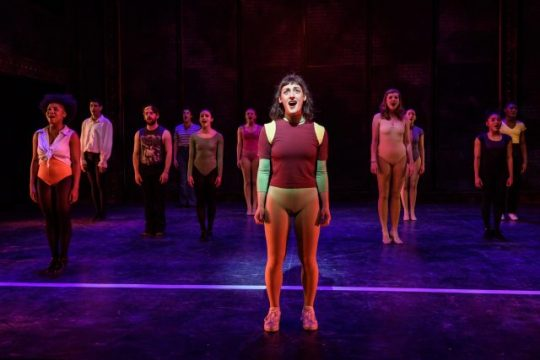 """(in spotlight) Adrienne Storrs as Diana Morales sings """"What I Did for Love"""" in 'A chorus Line' at Porchlight Music Theatre. (Photo by Michael Courier)"""