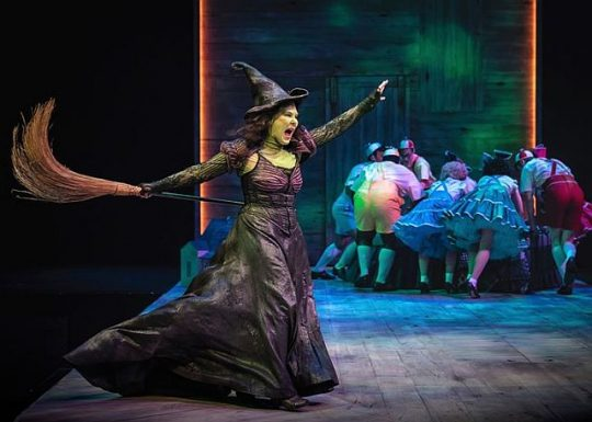 The Wicked Witch of the West (Hollis Resnick) frightens the Munchkins. (Photo by Liz Lauren)