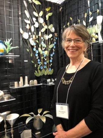 St. Jospeph, MI artist Rebecca Hungerford's flowers are pewter. (J Jacobs photo