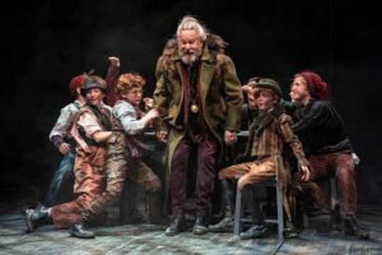 "William Brown (center) stars as aging pickpocket Fagin in ""Oliver!"" at the Marriott Theatre. (Liz Lauren photo)"