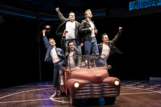 The Burger Palace Boys and car in 'Grease' at Marriott Theatre. (Liz Loren photo)