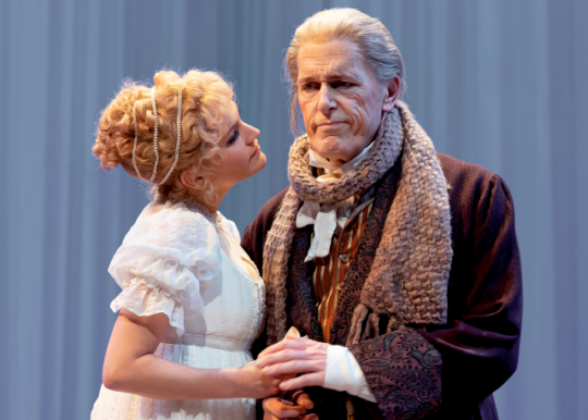 Emma (Lora Lee Gayer) comforts her father, Mr. Woodhouse (Larry Yando) in Emma at Chicago Shakespeare. (Photo by Liz Lauren)