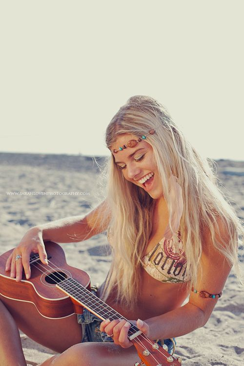 sexy hippie fun on beach guitar