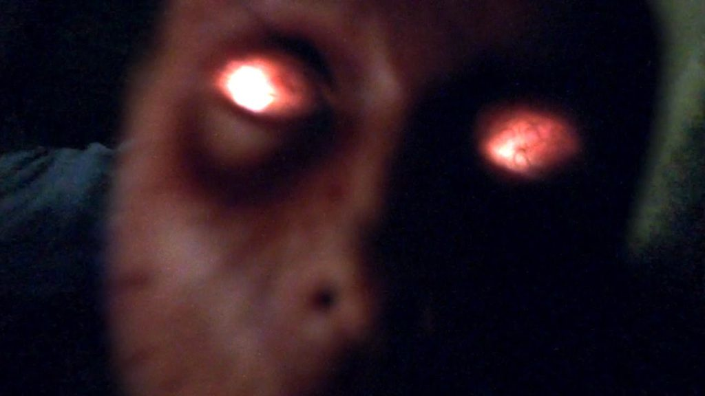 possessed man with red eyes