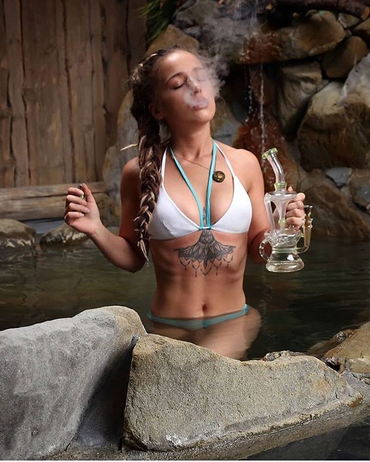 girl in jacuzzi smoking weed