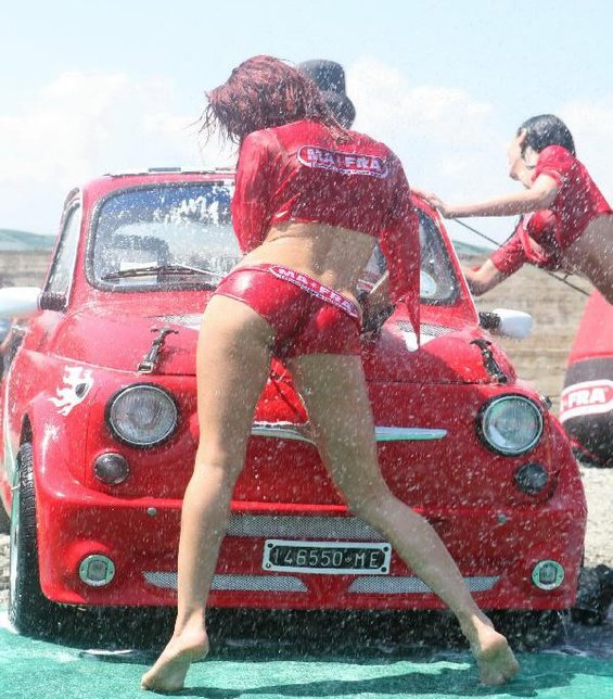 italian women washing cars having fun