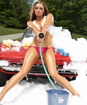 girl aiming hose at camera