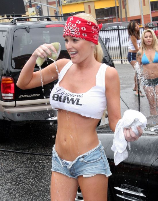 blonde babe with bandana washing car in halter top
