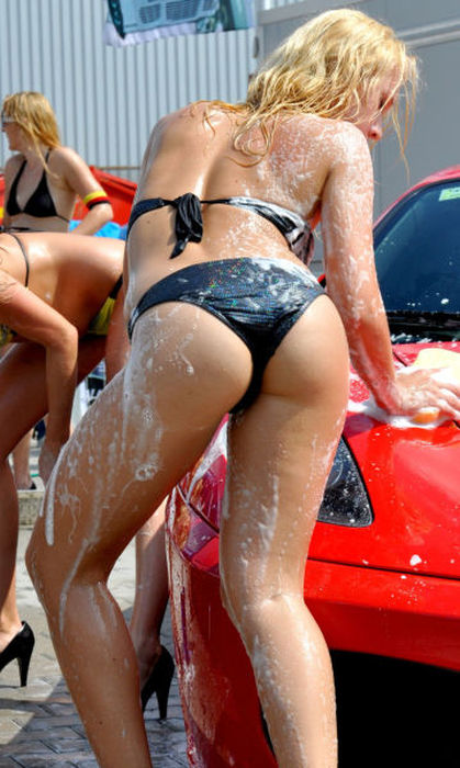 blonde in black bathing suit washing car