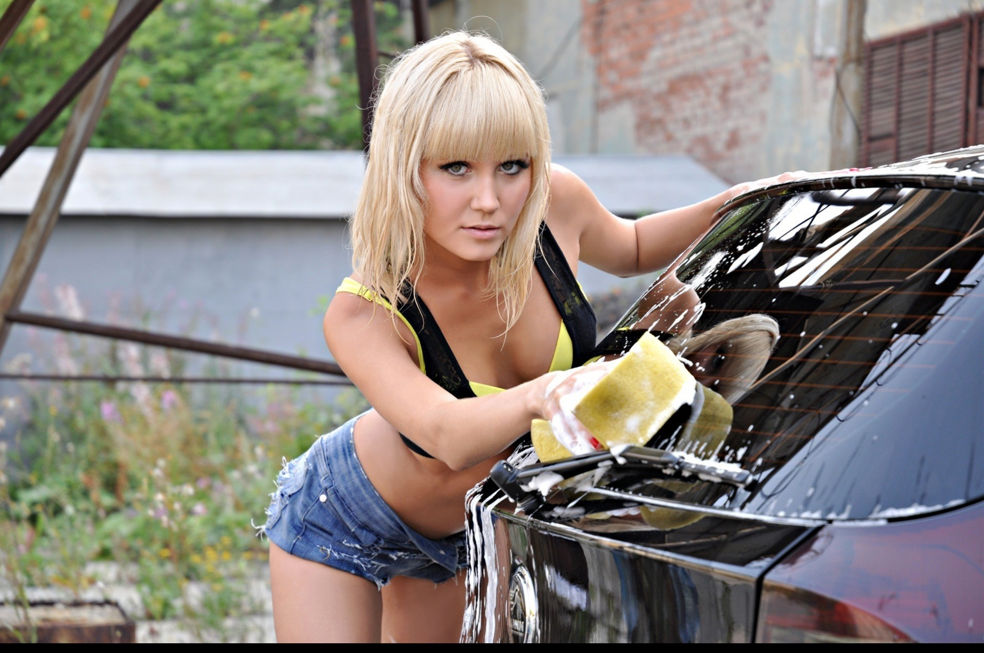 cute blonde washing car
