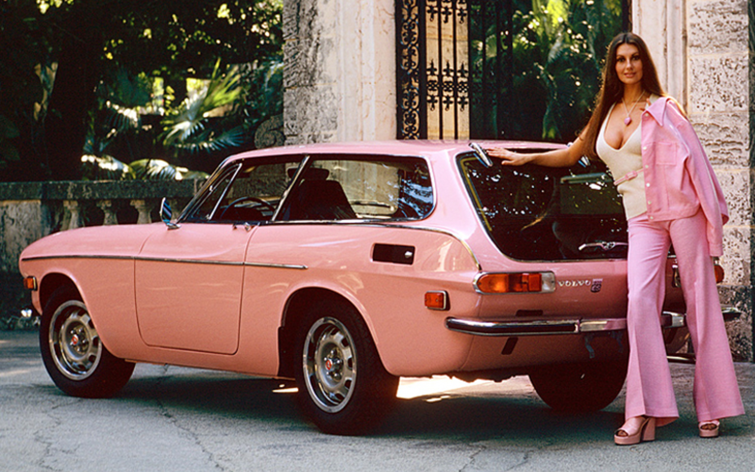 busty brunette with classic pink automobile car