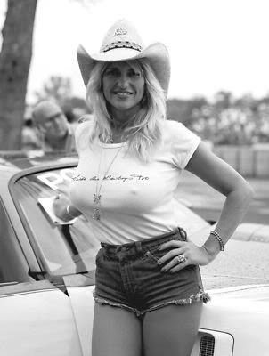 busty blonde with cowboy hat golden shifter racing pit girl