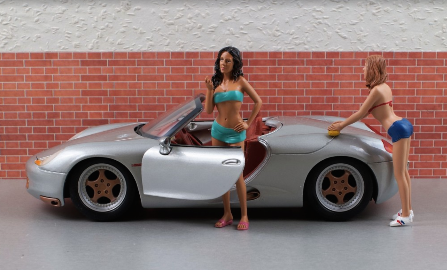 little models with gray toy car