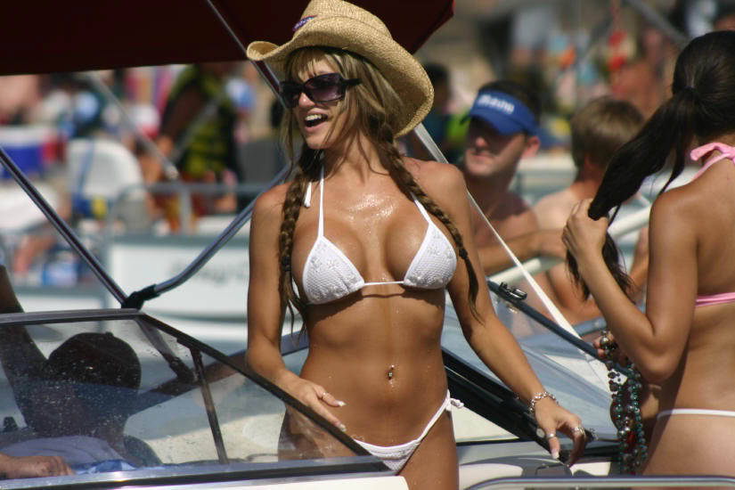 girl in white bikini with great body and cowboy hat