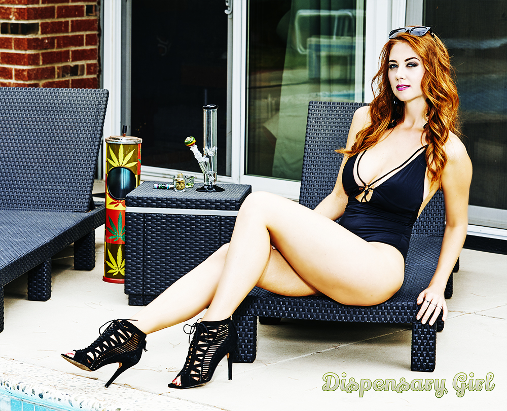 gorgeous redhead in black bikini with bong and heels