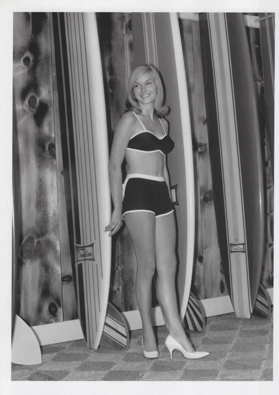 classic tall blonde with surfboards and white high heels