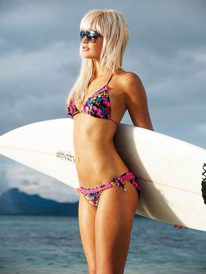 blonde surfer girl with sunglasses and surfboard and bikini