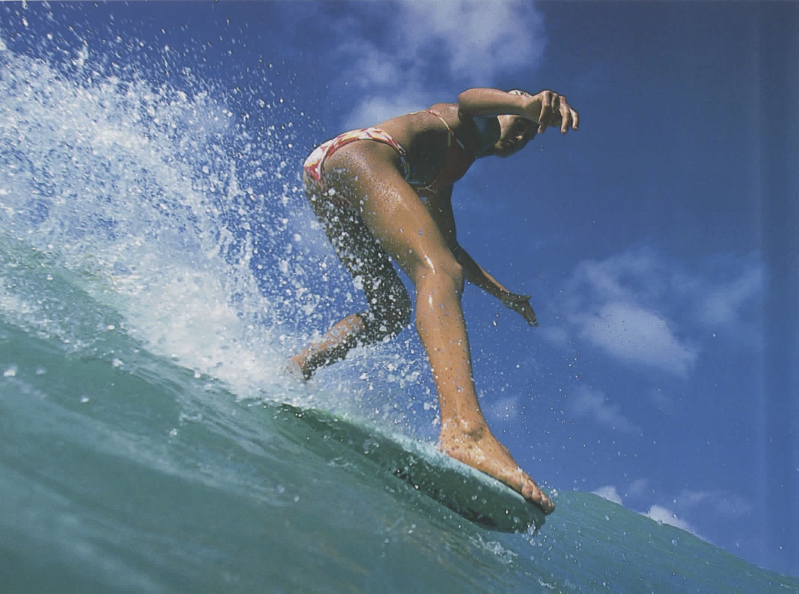 surfer girl on top of wave