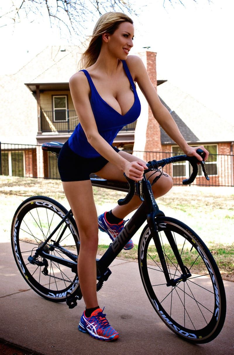 busty babe with blue top on bike