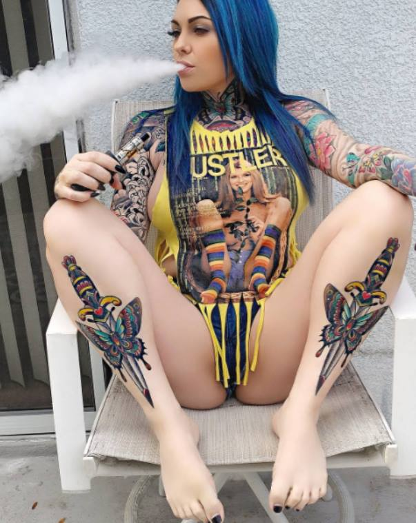 tattoo babe hustler shirt blue hair hot breasts getting stoned high vape