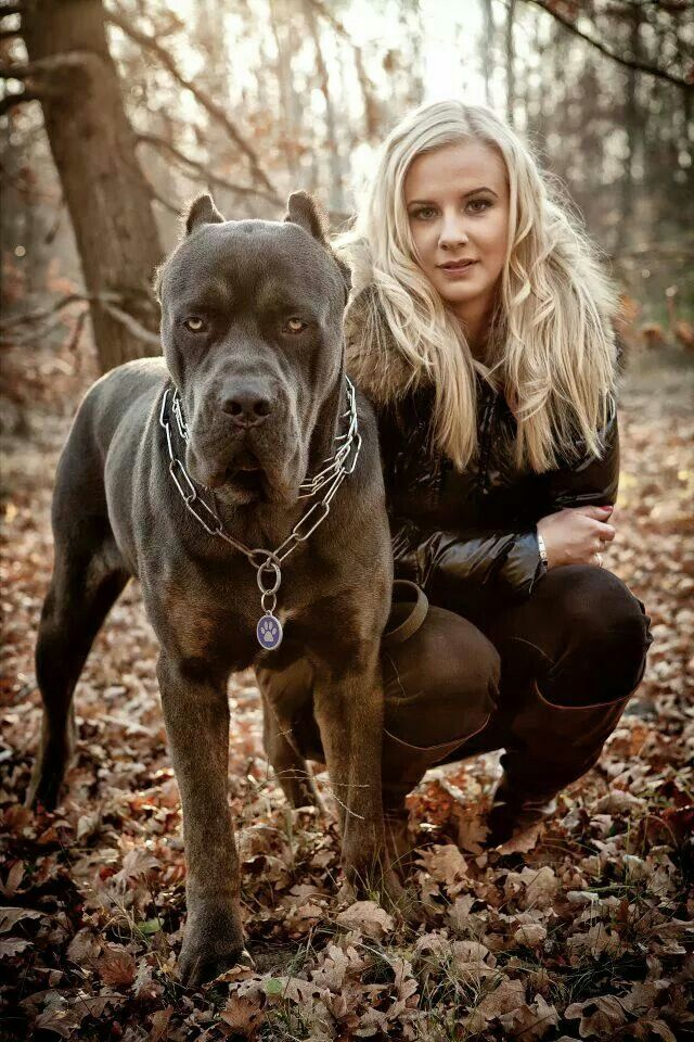 blonde babe with mean black guard dog