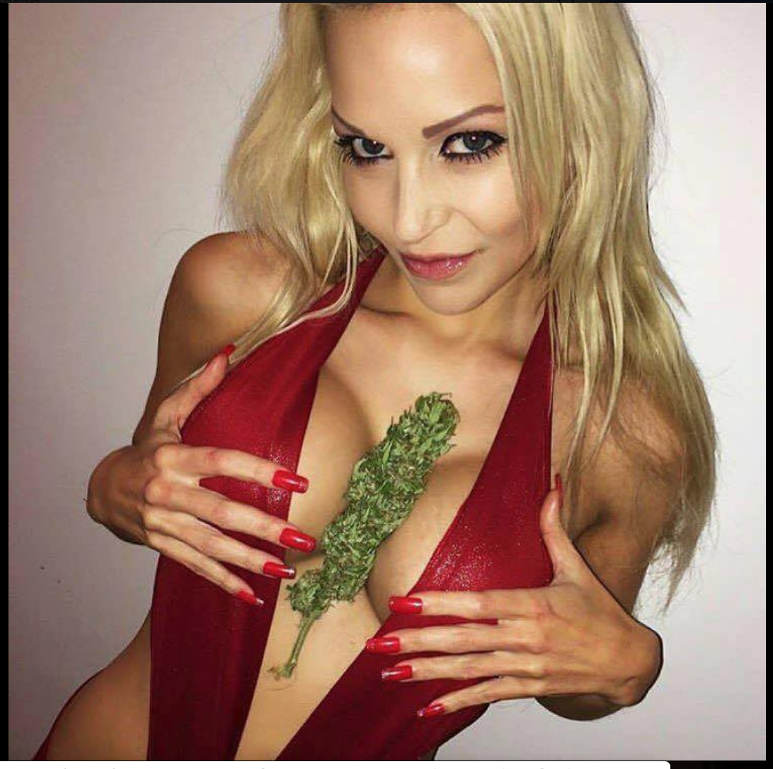 blonde babe with green bud between breasts