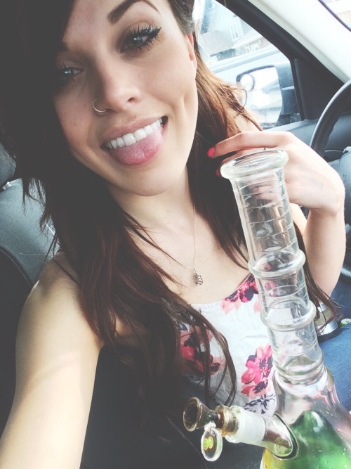 cutie with tongue out and nose ring