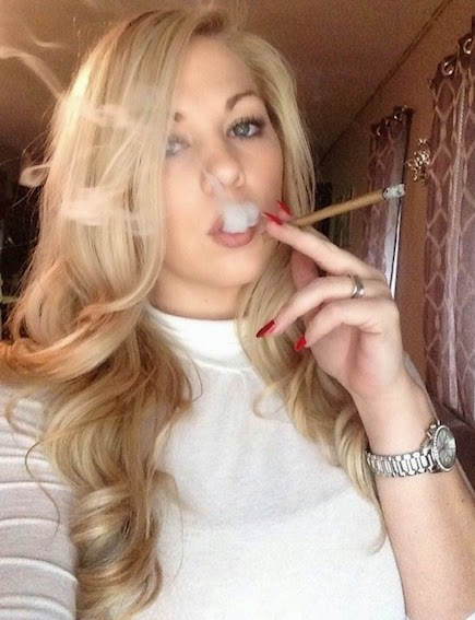 blonde elegant hottie with curly blonde hair and watch blunt