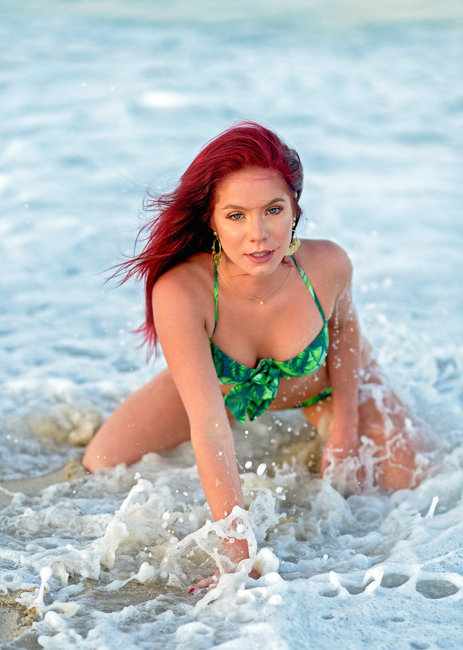 redhead splashing around in green bikini