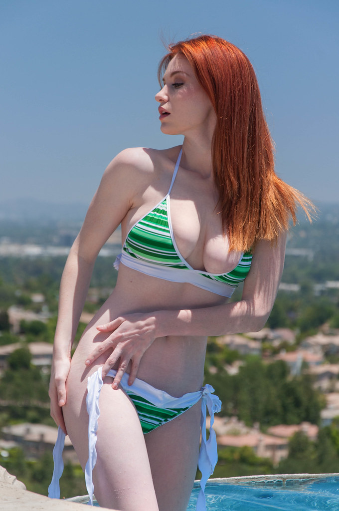 redhead babe in green bikini at pool