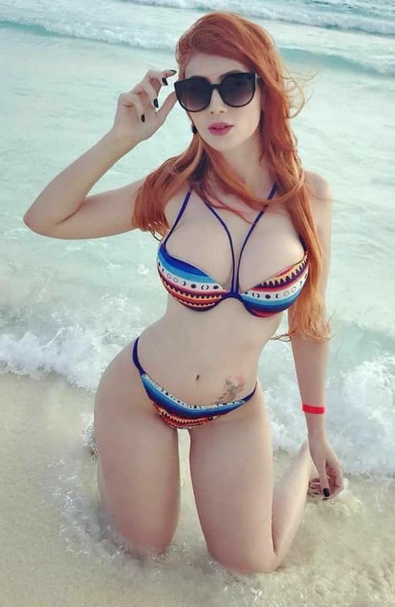 busty tattooed redhead with sunglasses blowing us away