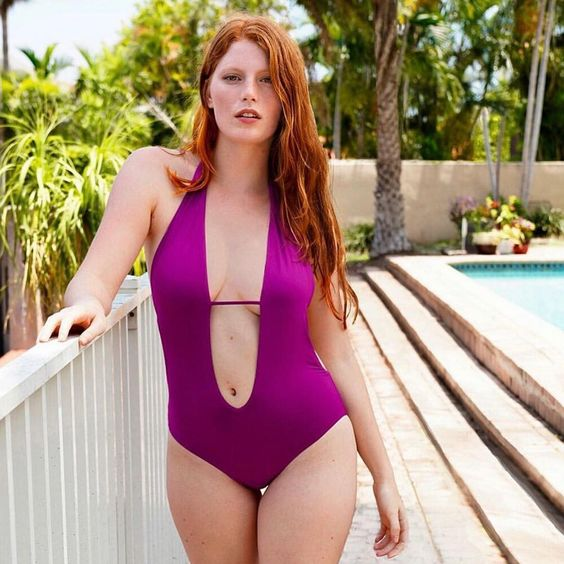 gorgeous redhead in purple bikini