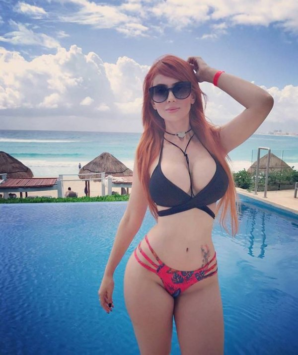 busty redhead tattoo sunglasses pool
