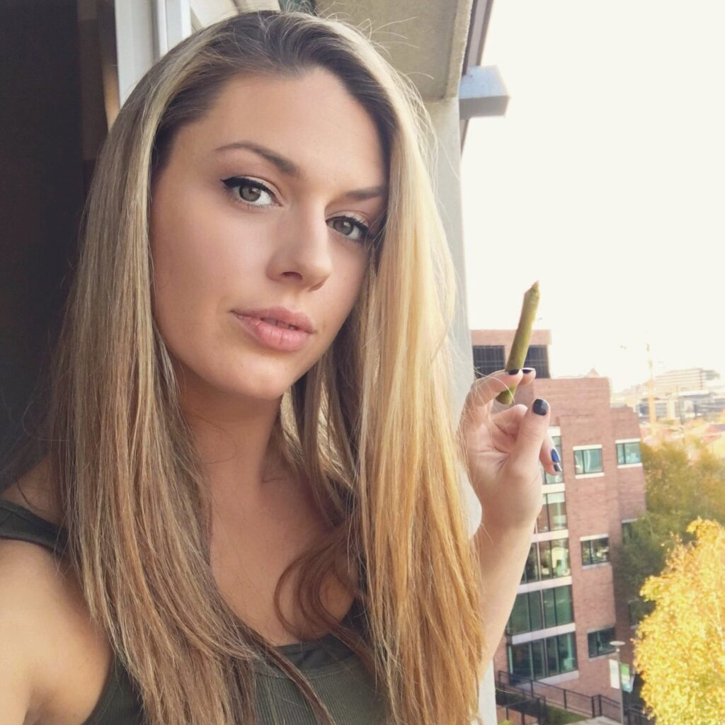 good looking blonde with joint on a deck beauty