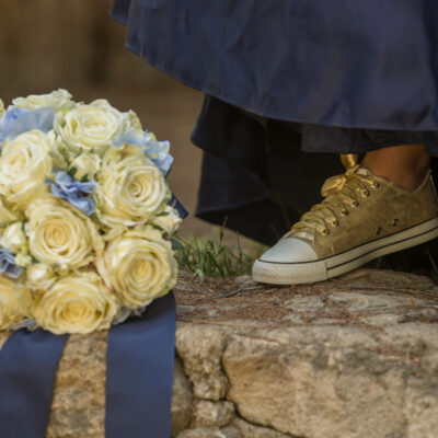 Detail,Of,Golden,Tennis,Shoes,,Elegant,Blue,Dress,And,A