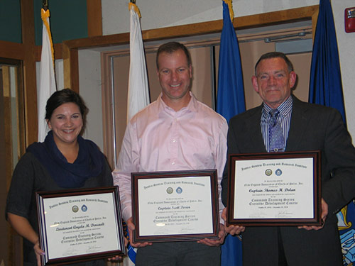 three people holding framed certificate awards
