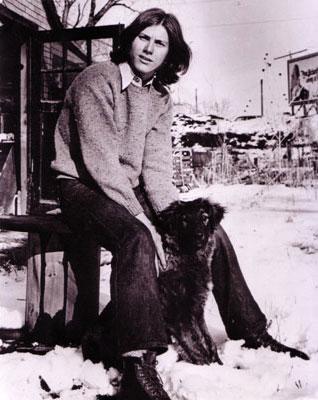 Darryl and his dog, Koya in backyard at 117 Cedar on the West Bank                                    in Minneapolis, 1970.   Photo: Alain Lizee.