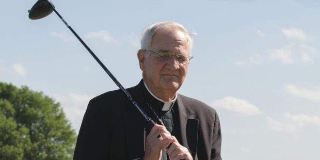 Priest with golf club