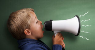 young boy talking into a megaphone