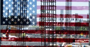 Steel girders behind American Flag