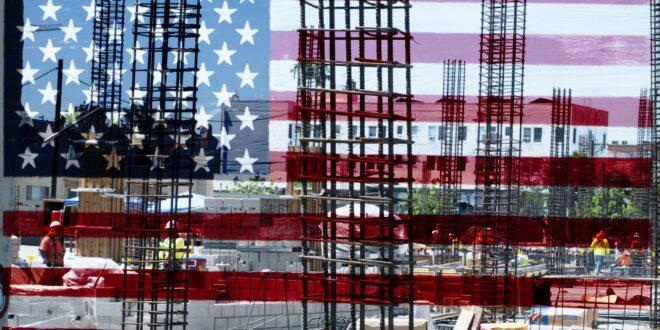 Steel girders behind American Flag
