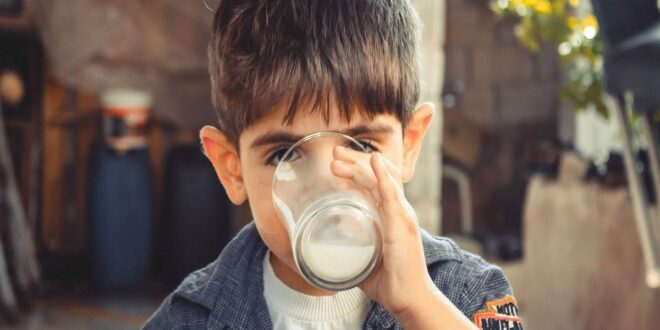 boy drinking glass of milk