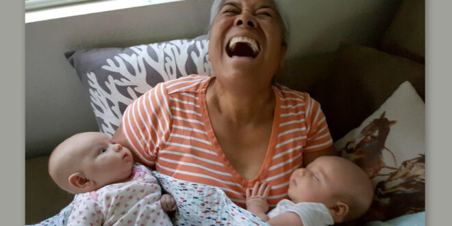 Happy Lady with 2 babies