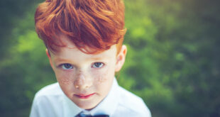 Red-headed boy with bow tie