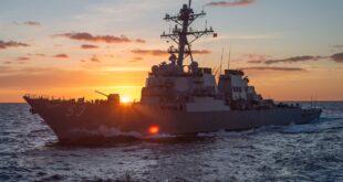 battleship at sunrise on the ocean
