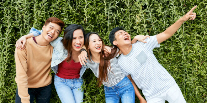 four friends together laughing