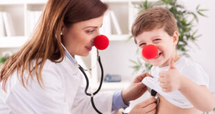 female doctor and child with red noses