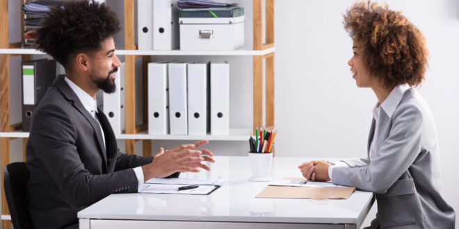 man and woman in an interview